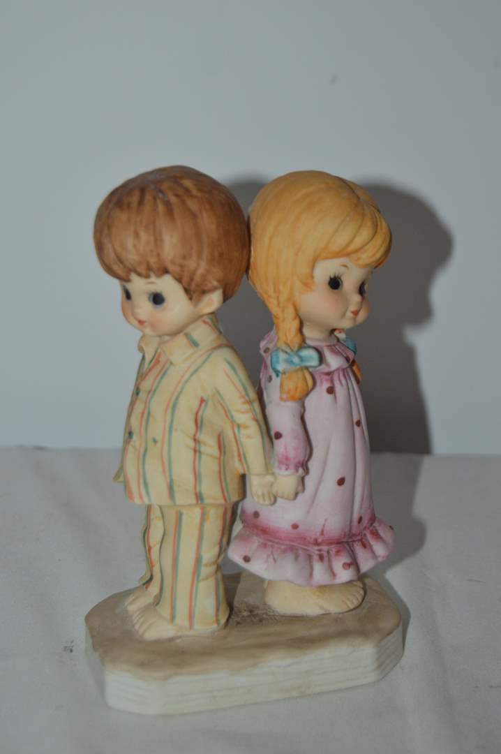 Lot # 61 Porcelain girl and boy in pajamas holding hands figurine (main image)