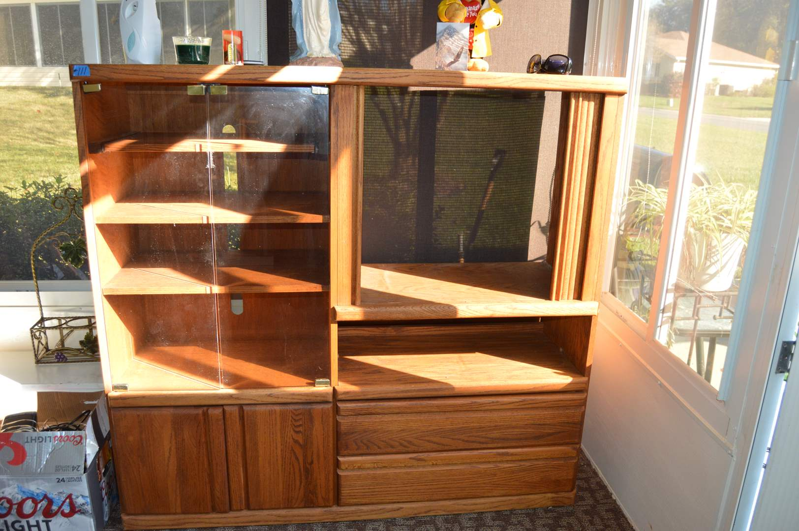 Lot # 111 Wood entertainment center with glass door display & storage (main image)