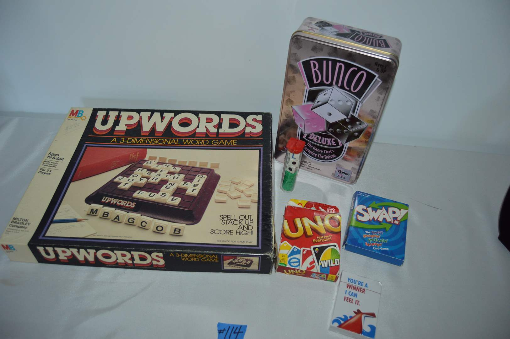 Lot # 114 Games - Upwords, Bunco, UNO, Swap, LRC & cards (main image)