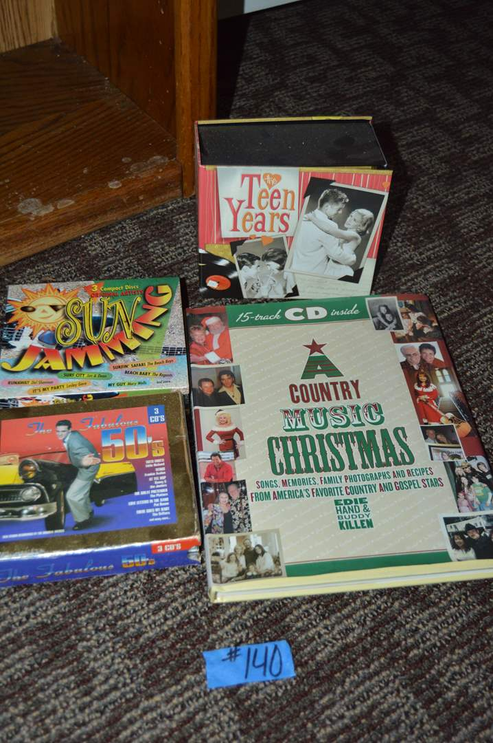 """Lot # 140 CD box sets and """"A Country Music Christmas"""" book with CD (main image)"""