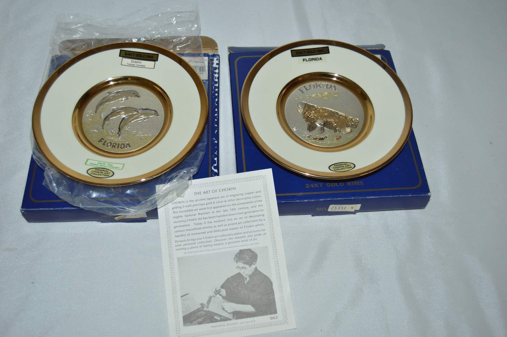 Lot # 144 2 Dynasty Chokin plates w/ boxes and paperwork - Dolphin & Florida Manatees (main image)