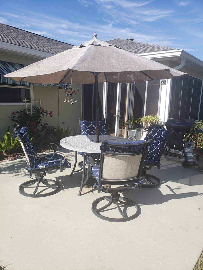Lot # 243 Heavy outdoor rod iron patio set with cushions & umbrella (main image)