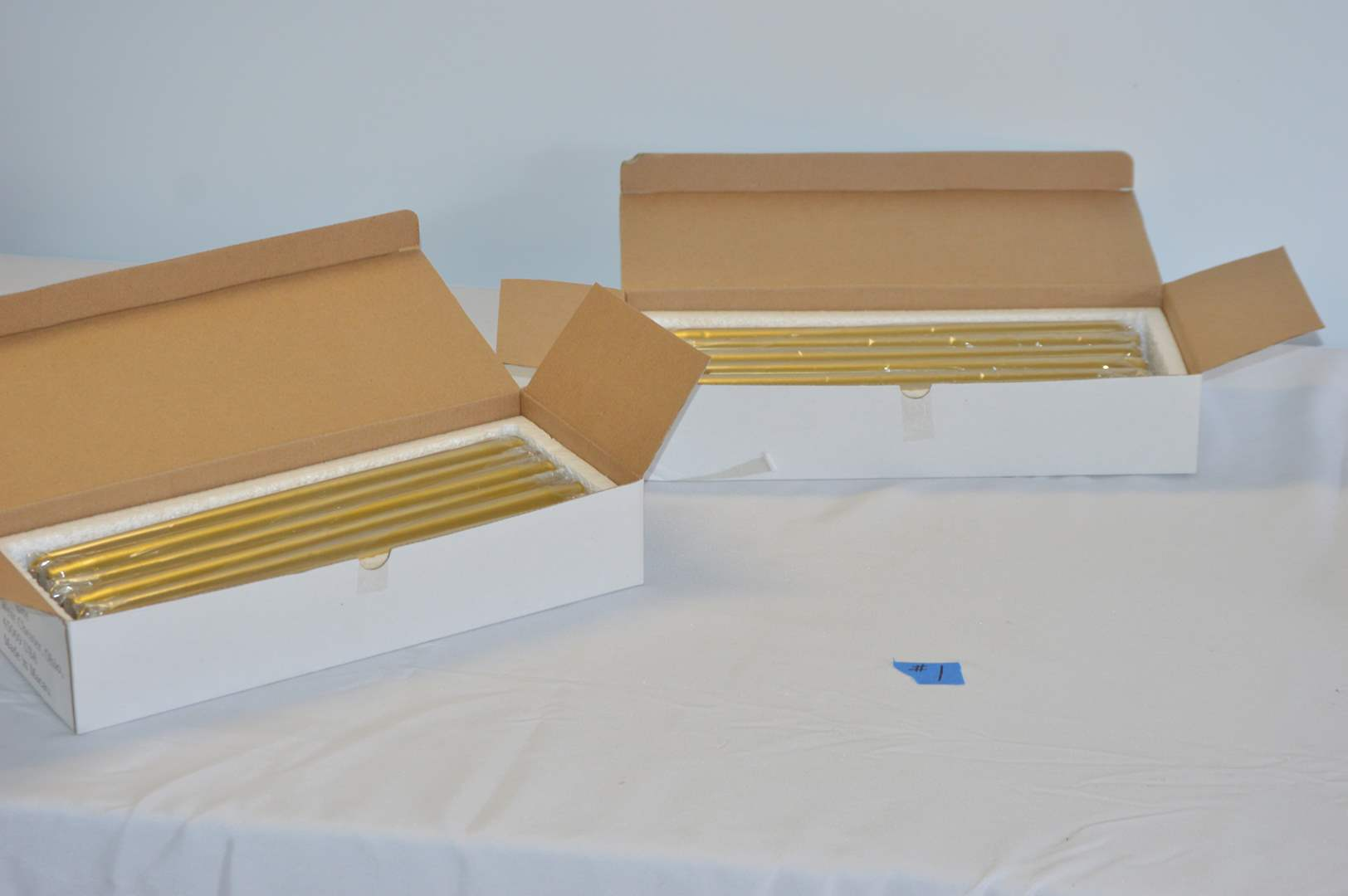 Lot # 1 New boxes of Frongate gold taper candles - 2 @ 12 per box (main image)
