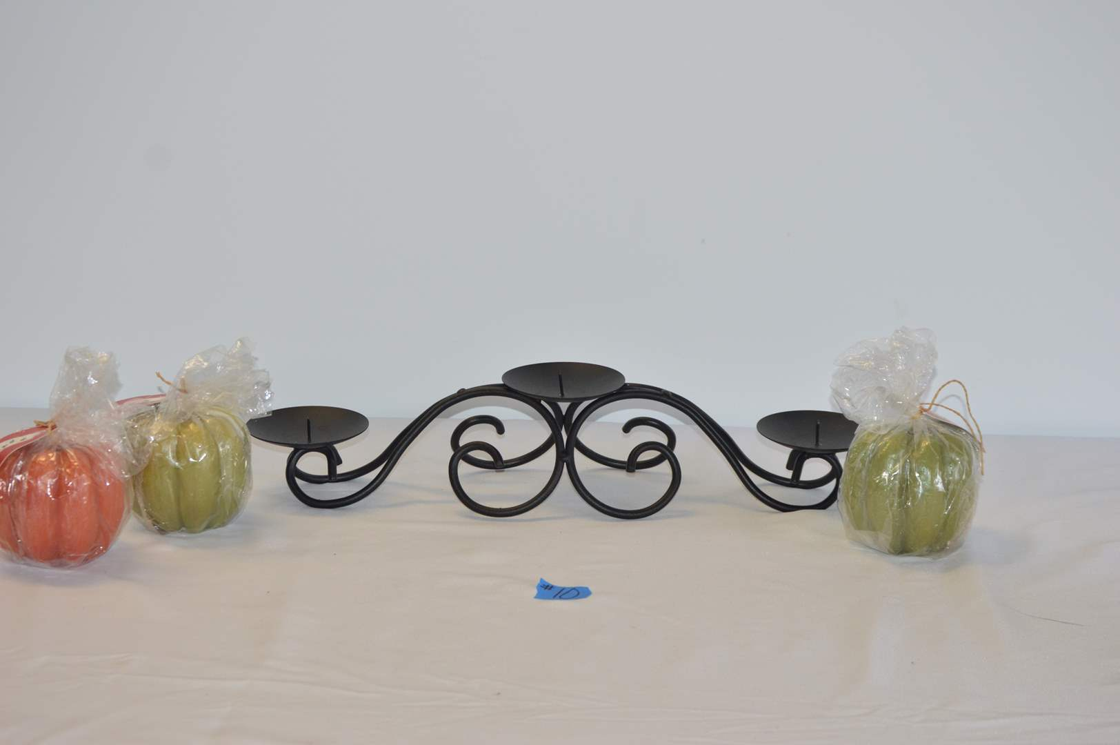 Lot # 10 Rod iron candle centerpiece w/ 3 new candles (main image)