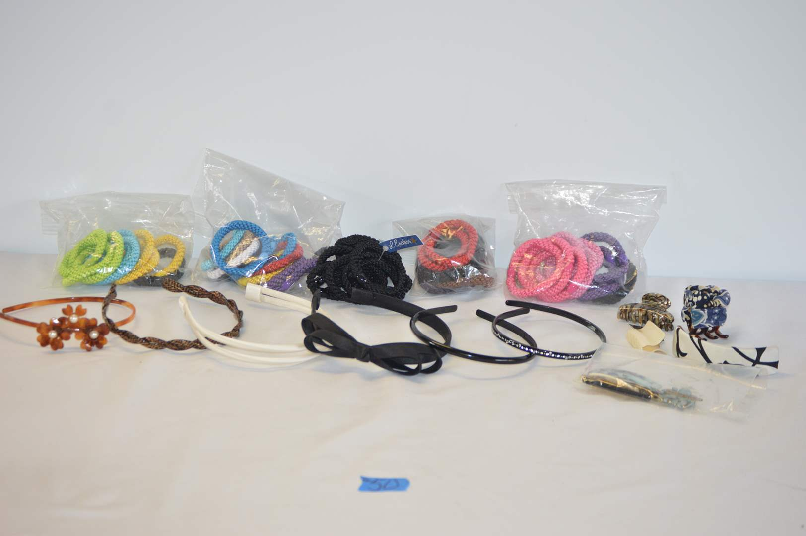 Lot # 50 L. Erikson Grab & Go ponytail holders, Headbands and hair clips (main image)