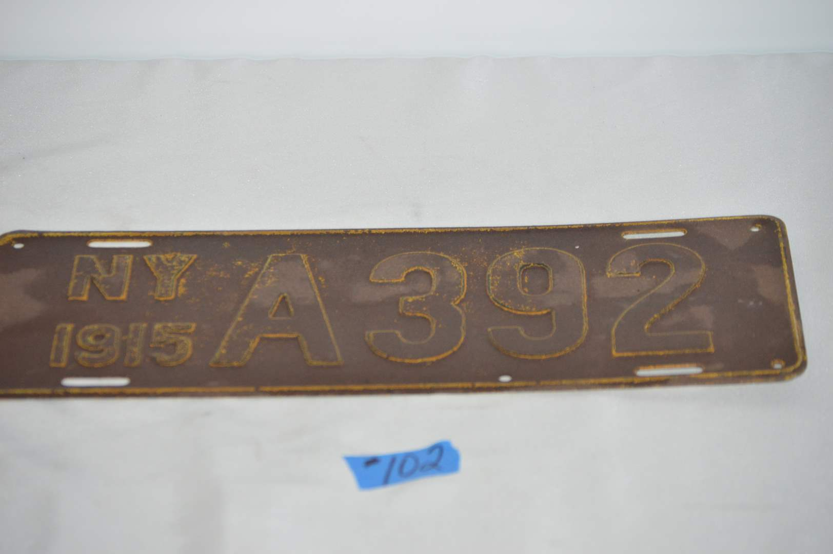 Lot # 102  Antique 1915 New York license plate (main image)