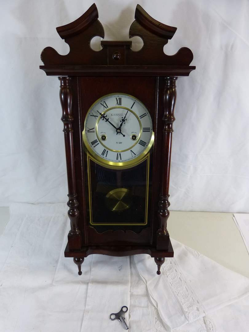 """Lot # 80 26X30"""" Kassel wood clock with key and Pendulum (missing center piece on top) (WORKING) (main image)"""