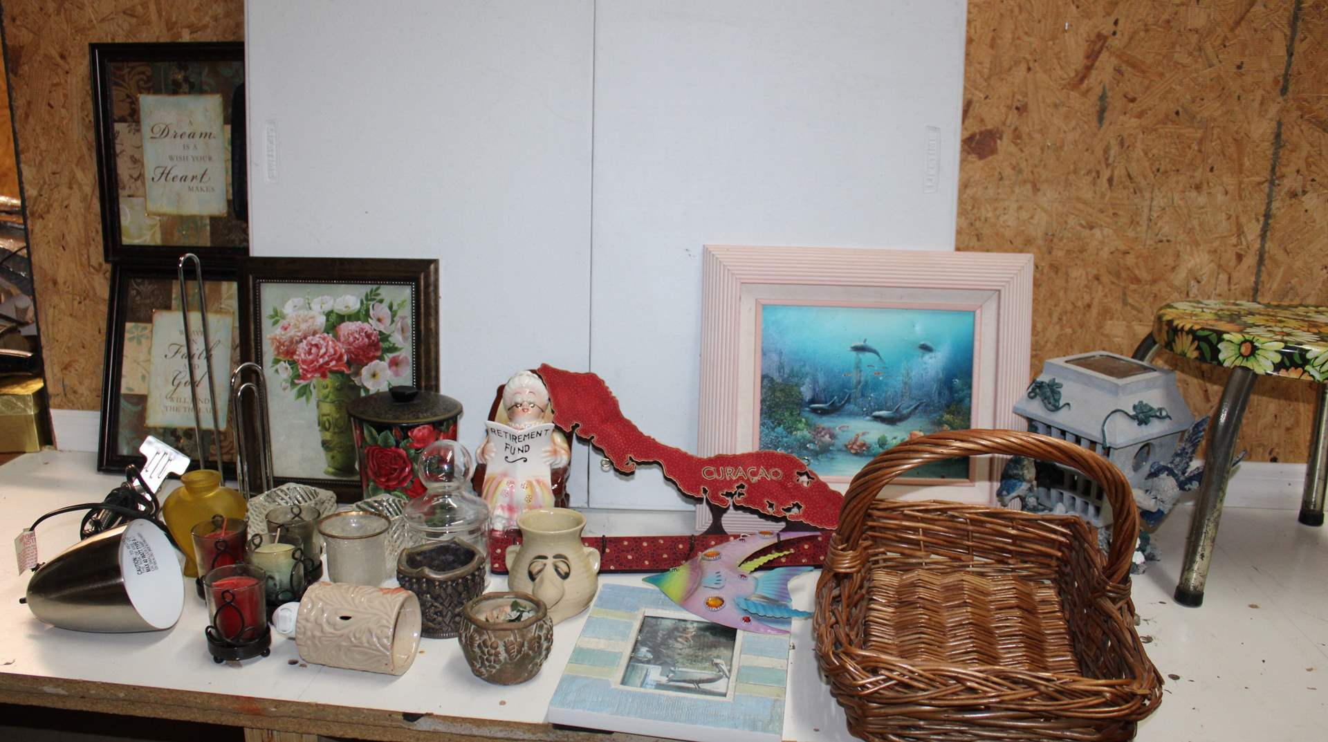Lot#103 Wall art, dolphin painting, basket, candle holders, paper towel holder, desk lamp, metal stool, decor  (main image)
